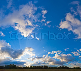Evening blue sky panorama with clouds over plain and camp on forest Four shots stitch image