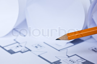 Architectural blueprints ofbuilding with a pencil