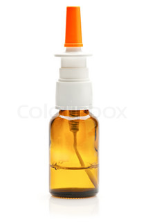 Bottle of nasal spray medication over white background