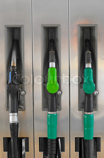 Several gasoline pump nozzles at petrol station