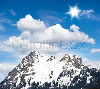 alpine winter landscape with beautiful blue cloudy sky high mountains with snow