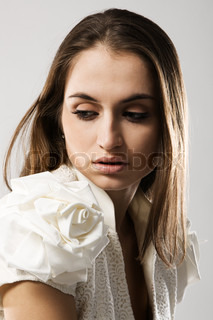 Fashion model in stylish dress, studio portrait