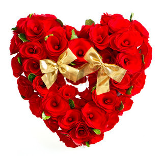 heart of red roses with golden bow on white background