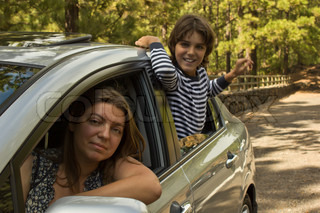 mom amd son traveling together by a car