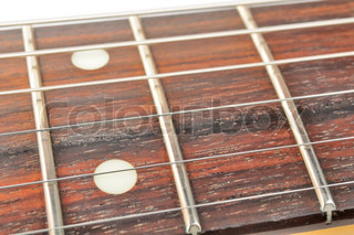 Electric Guitar Fingerboard (Fretboard) with Strings Close-Up