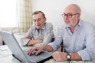 man computing with senior