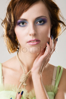 Beautiful woman with hangman's noose, studio photo