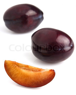 Sweet plum with slice in closeup