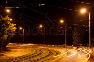 Night view of a main road with speeding cars lights