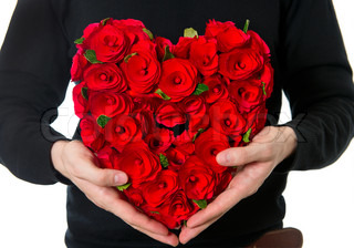 man's hands with red roses