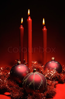 Red christmas decoration theme - three red baubles and three red candles