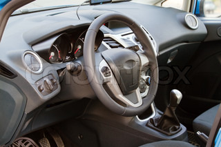 Interior of a modern car, steering wheel and dashboard