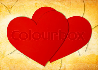 two red paper hearts on grunge
