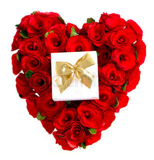 heart of red roses with a gift box on white background