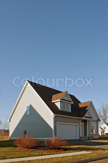 Modern custom built house newly constructed with a 2 car garage in a residential neighborhood