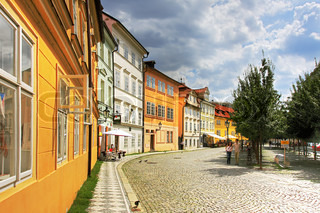 View on old street with multicolored houses in Prague