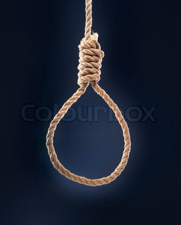 Rope noose with hangman's knot hanging in front of blue background