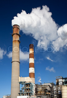 Power plant with white smoke out of smokestack