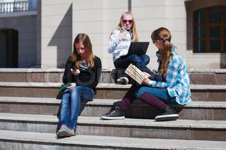 Teenage schoolgirls on the steps