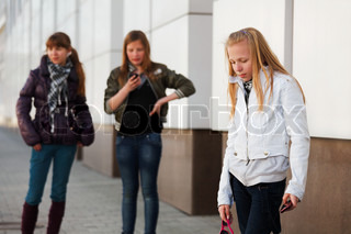 Teenage girls with a mobile phones