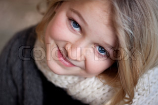 Close up of Beautiful child looking up at the camera, shallow depth of field