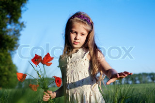 An image of a beautiful girl in the field with poppies
