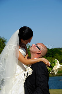 Bride and groom are about to kiss