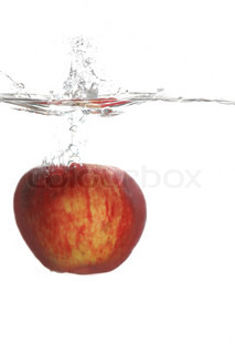 Red apple falling in water