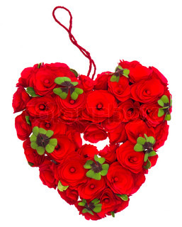 red heart of roses and clover leaves on white background