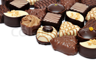 hand made chocolate candies over white background