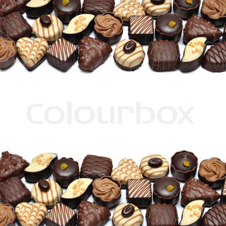 Border of Different chocolate candies over white background