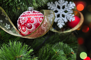 Colorful christmas decoration hanging on christmas tree