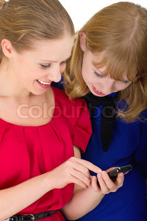 two happy pretty girls with a mobile phone