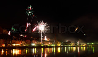 multicolor fireworks in small German town Cochem close to river