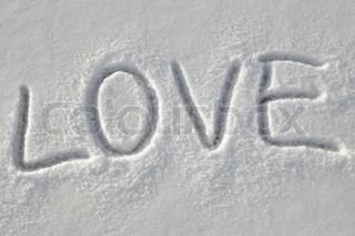Written word love on a snow white field