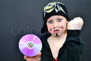 Fearsome boy pirate pointing at a cd-disc and showing fist