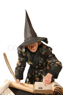 Wizard isolated on white writing in books
