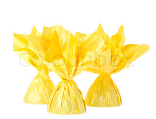 a yellow candy, isolated on white
