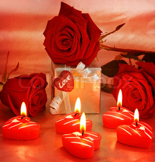 Romantic gift & red roses with candles, love concept