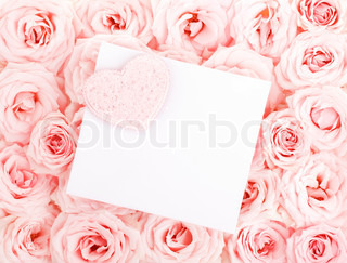 Pink fresh roses background with red heart & isolatedblank greeting card, love concept