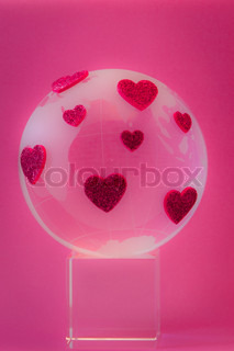 Planet of love. Glass globe with red hearts. Concept of Valentines day.