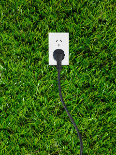 Conceptual renewable images isolated against artificial lawn