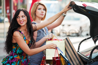 Two young shopper with a car