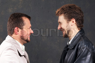 An image of two men looking onto each other