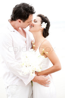Wedding couple kissing on the beach