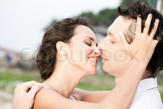 Portrait of kissing attractive couple
