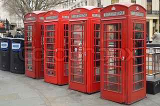 red telephone boxes , london