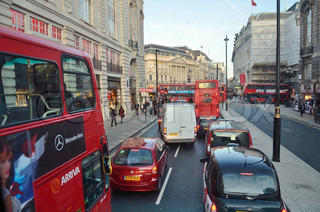 traffic with taxis and double decker buses in London