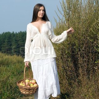 Rural women's portrait with basket of apples
