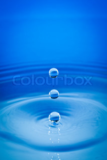 Three drops of water fall downwards